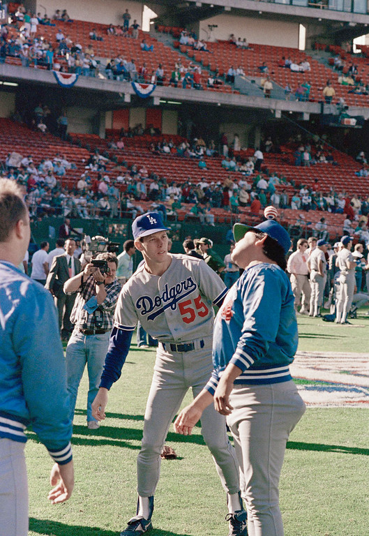 . Los Angeles Dodgers Fernando Valenzuela, right, bounces a bean bag off his head at fellow pitcher Orel Hershiser, who is expected to start Thursday\'s game five of the World Series against the Oakland A\'s. The Dodgers engaged in the horseplay on the field of Oakland Coliseum, Wednesday, Oct. 19, 1988 during the pregame workout. (AP Photo/Lennox McLendon)