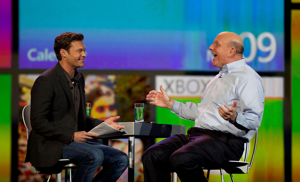 . Microsoft CEO Steve Ballmer, right, talks with Ryan Seacrest during his keynote address at the 2012 International CES tradeshow, Monday, Jan. 9, 2012, in Las Vegas. CES, the world\'s largest consumer electronics exhibition starts Tuesday. (AP Photo/Julie Jacobson)
