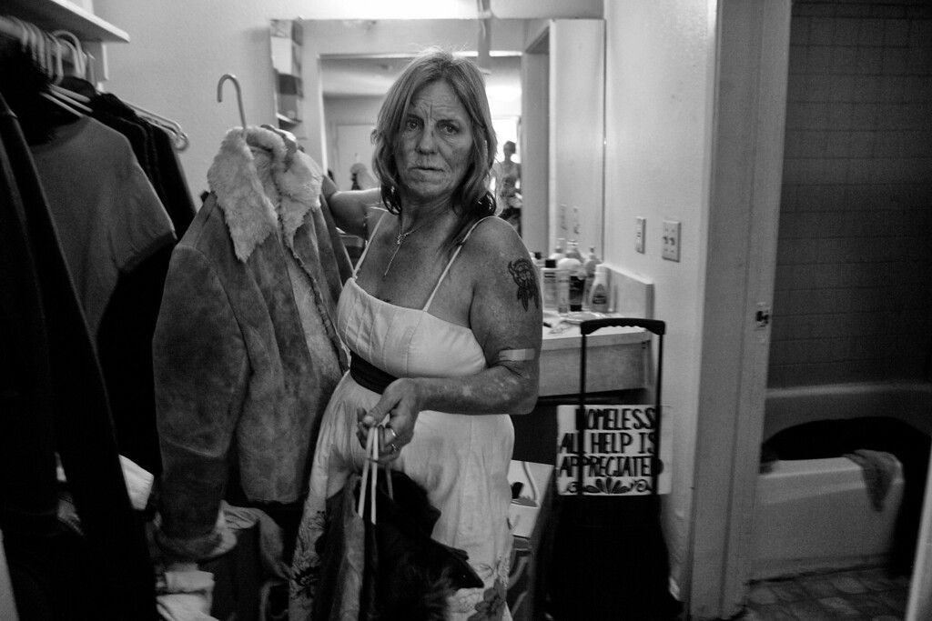 . Dorothy works to organize her belongings.