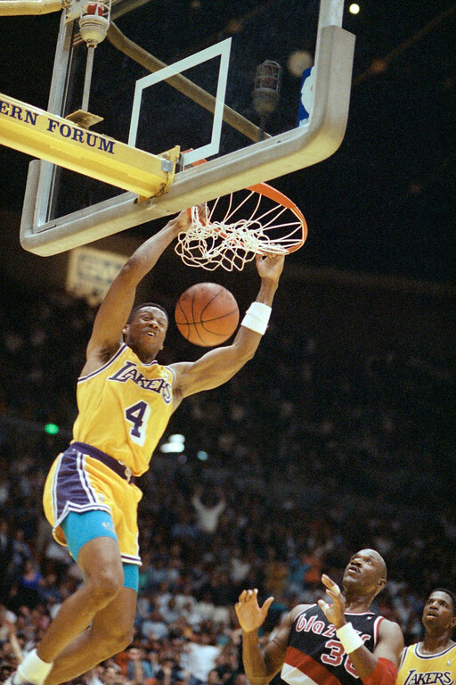 . Byron Scott, left, of the Los Angeles Lakers dunks over Terry Porter of the Portland Trail Blazers during the fourth quarter of their NBA Western Conference Playoff Game at the Forum in Inglewood, Calif., Sunday, May 26, 1991 Scott helped the Lakers to a 115-95 win and a 3-1 lead in the best-of-seven championship series. (AP Photo/Bob Galbraith)