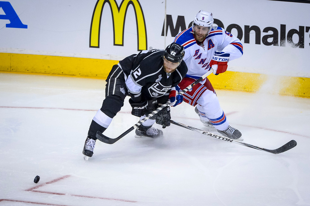 . Kings Marian Gaborik and Rangers Dan Girardi go after the puck during third period action at Game 1 of the Stanley cup Finals at Staples Center Wednesday, June 4, 2014 ( Photo by David Crane/Los Angeles Daily News )