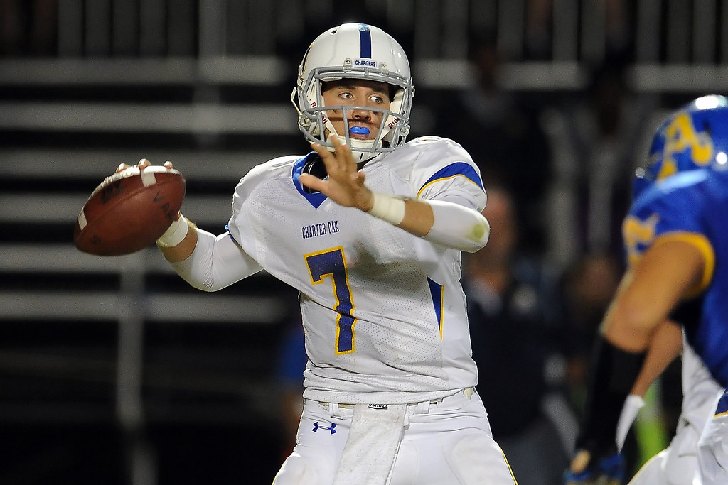 . Charter Oak quarterback Kory Brown passes against Bishop Amat in the first half of a prep football game at Bishop Amat High School in La Puente, Calif. on Friday, Sept. 20, 2013.    (Photo by Keith Birmingham/Pasadena Star-News)