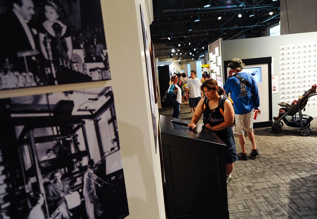 . Fair-goers visit the Pencil 2 Pixels: The Art of Animation exhibit at the 91st annual Los Angeles County Fair in Pomona on Sept. 2, 2013. The fair will run through September 29. (Rachel Luna / San Bernardino Sun)