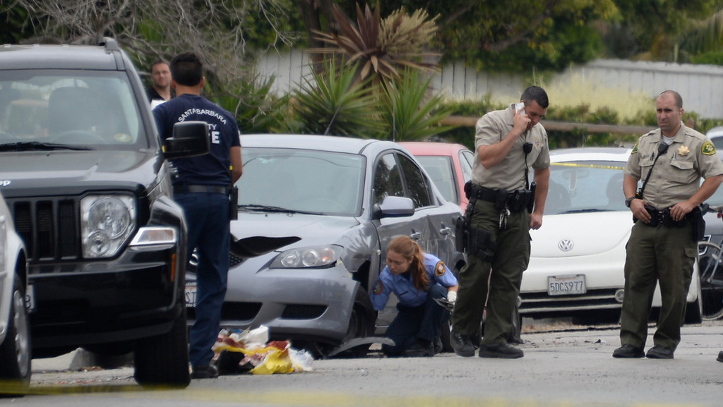 . May 24-,2014. Isla Vista, CA. Investigators at the scene where a drive-by shooter left seven people dead Friday night, including the attacker, and seven others wounded, authorities said Saturday.  The gunman got into two gun battles with deputies Friday night in the beachside community of Isla Vista before crashing his black BMW into a parked car. Photo by Gene Blevins/LA Daily News