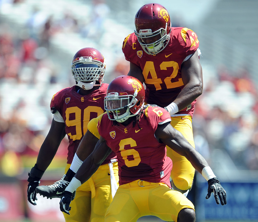 . Southern California\'s Josh Swah (6) reacts with teammates after after tackling Boston College running back David Dudeck (not pictured) for a loss of yards during the first half of an NCAA college football game in the Los Angeles Memorial Coliseum in Los Angeles, on Saturday, Sept. 14, 2013.