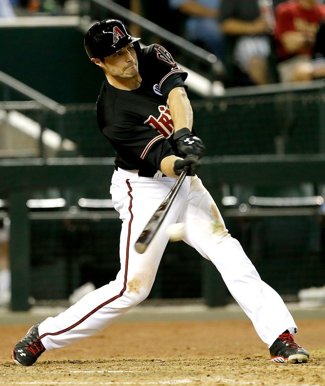 . Arizona Diamondbacks\' Aaron Hill hits against the Los Angeles Dodgers during the seventh inning of a baseball game, Wednesday, July 10, 2013, in Phoenix. (AP Photo/Matt York)