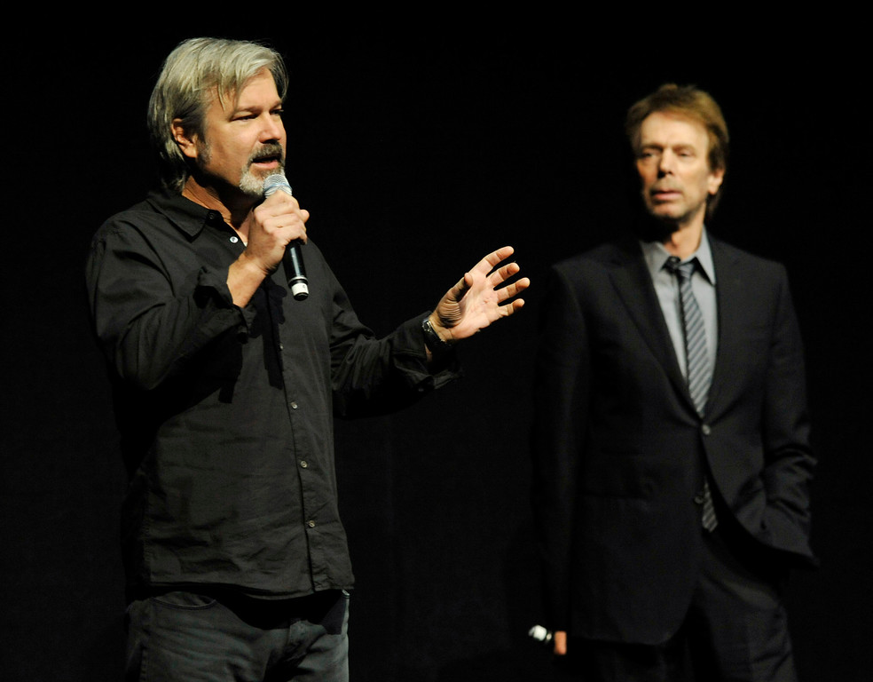 """. Gore Verbinski, left, director of the upcoming film \""""The Lone Ranger,\"""" addresses the audience as the film\'s producer Jerry Bruckheimer looks on during the Walt Disney Studios presentation at CinemaCon 2013 at Caesars Palace on Wednesday, April 17, 2013 in Las Vegas. (Photo by Chris Pizzello/Invision/AP)"""