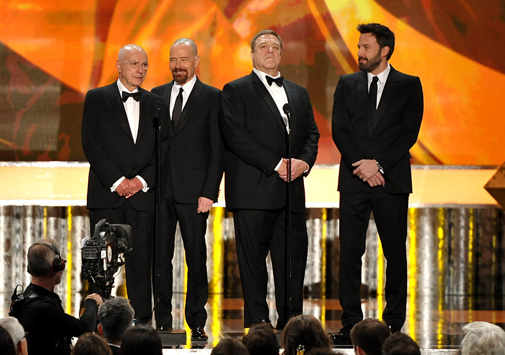 """. Castmembers from \""""Argo\"""", from left, Alan Arkin, Bryan Cranston, John Goodman and Ben Affleck speak onstage at the 19th Annual Screen Actors Guild Awards at the Shrine Auditorium in Los Angeles on Sunday Jan. 27, 2013. (Photo by John Shearer/Invision/AP)"""
