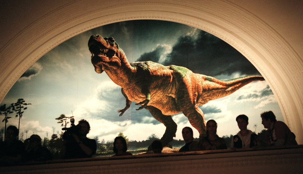 . Visitors occupy a balcony at the Field Museum to get a birds-eye view of Sue, the largest and most complete Tyrannosaurus rex ever found May 10, 2000 in Chicago. The fossil was found by Susan Hendrickson in South Dakota in 1990 and was acquired by The Field Museum in 1997 for $8.4 million at Sotheby\'s auction house in New York. (Photo by Tim Boyle/Newsmakers)