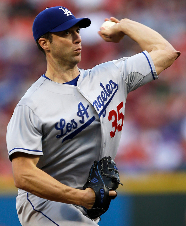 . Los Angeles Dodgers starting pitcher Chris Capuano throws to a Cincinnati Reds batter in the first inning of a baseball game, Friday, Sept. 6, 2013, in Cincinnati. (AP Photo/Al Behrman)