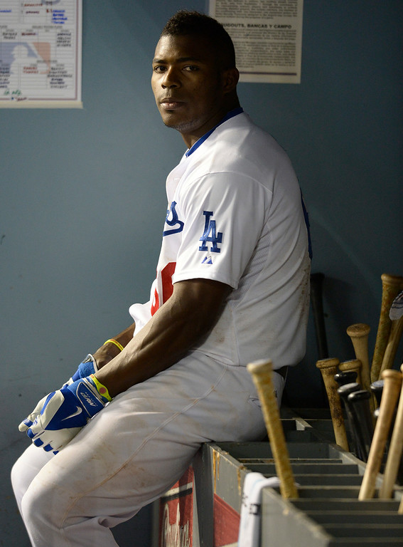 . Yasiel Puig sits next to the bat rack after grounding out in the 8th inning. The Dodgers lost to the San Diego Padres 4-1 at Dodger Stadium. Los Angeles, CA. 8/20/2014(Photo by John McCoy Daily News)