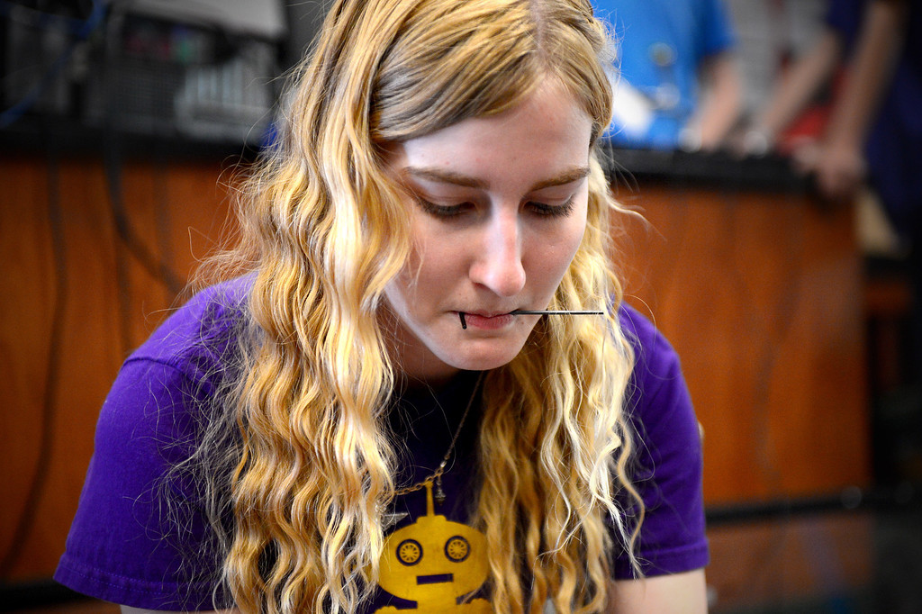 """. Melissa Johnson, 16, of The King and Queens, of Monrovia High\'s Robotics, rotates the scoops sprocket on her team\'s robot \""""Your Heiness\"""" as they practice for the World Championships Tuesday, April 8, 2014. The King and Queens, an all girl team, qualified to advance to the 2014 First Tech Challenge Robotics World Championships after competing in the West Super-Regional Robotics Tournament at McClellan Air Force Base this past weekend. The Monrovia team, the only qualifier from the Los Angeles area, joins three San Diego teams and four Northern California teams to be among the 128 top teams from around the world to compete at the First Robotics World Championships. (Photo by Sarah Reingewirtz/Pasadena Star-News)"""