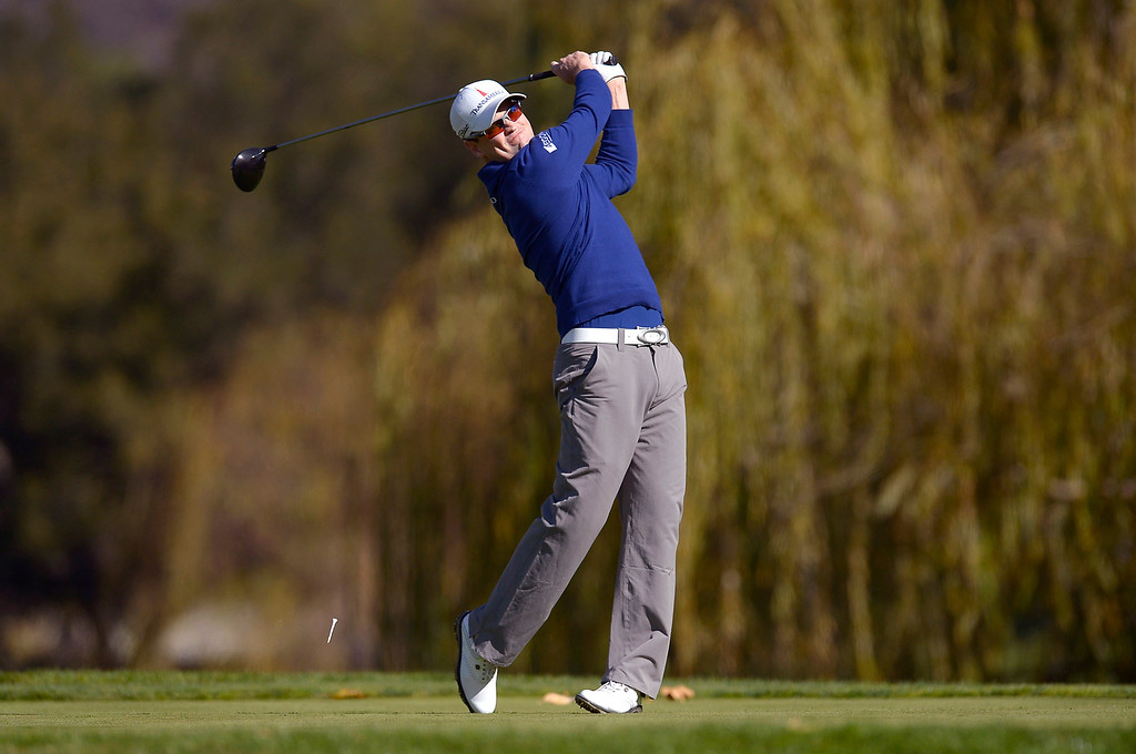 . Zach Johnson fires a tee shot  during the final round of the Northwestern Mutual World Challenge golf tournament at Sherwood Country Club, Sunday December 8, 2013, in Thousand Oaks, Calif.(Andy Holzman/Los Angeles Daily News)
