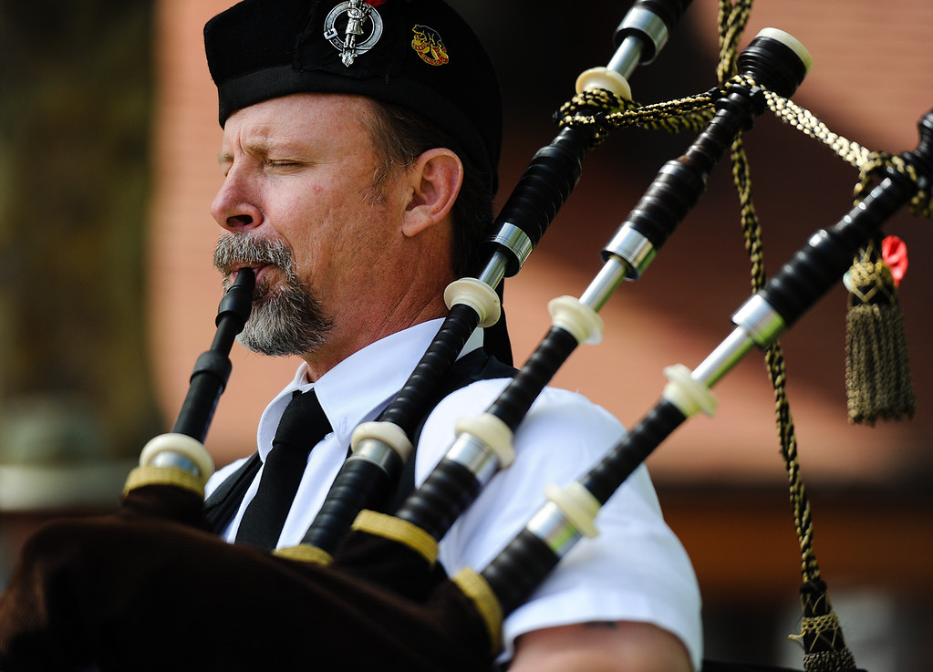 . Steve Moeller plays a bagpipe solo in honor of slain San Bernardino County Sheriff\'s Deputy Jeremiah MacKay as the Jeremiah MacKay bronze statue is unveiled in front of friends, family and the public at the Lake Arrowhead Village in Lake Arrowhead on Sunday, Sept. 1, 2013. San Bernardino County Sheriff\'s Detective MacKay was killed on Feb. 12 in a gun battle with fugitive ex-cop Christopher Dorner near Big Bear during a massive manhunt in search of Dorner. (Rachel Luna / Staff Photographer)