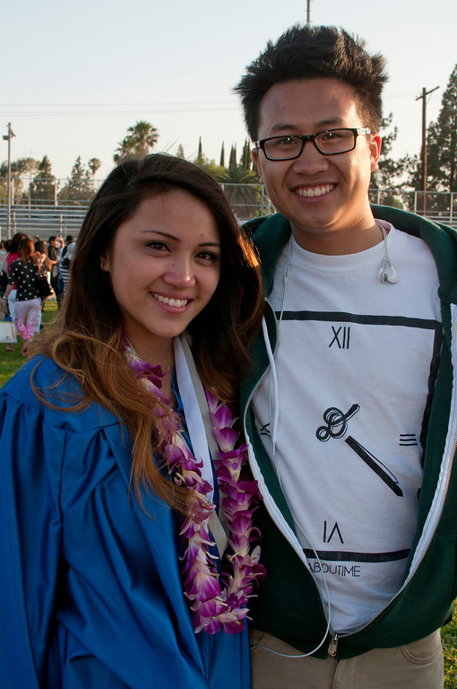 . Graduate Alexis Adriano receives a hug from her boyfriend Andrew Thai after the ceremony. The Reseda High School graduation class held their commencement in the school football field on Friday,  June 07, 2013 in Reseda, CA.   Photo by Carlos Carpio