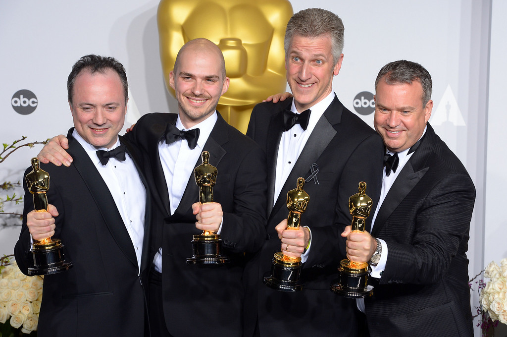 ". Tim Webber, Chris Lawrence, David Shirk, and Neil Corbould accept the Oscar for ""Achievement in Visual Effects\"" for the movie Gravity,  backstage at the 86th Academy Awards at the Dolby Theatre in Hollywood, California on Sunday March 2, 2014 (Photo by David Crane / Los Angeles Daily News)"