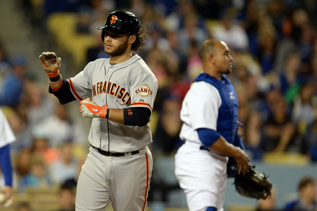 . The Giants\' Brandon Crawford #35 heads for the dugout after hitting a 2-run homer in the 5th during their game against the Dodgers at Dodger Stadium Friday, May 9, 2014. (Photo by Hans Gutknecht/Los Angeles Daily News)