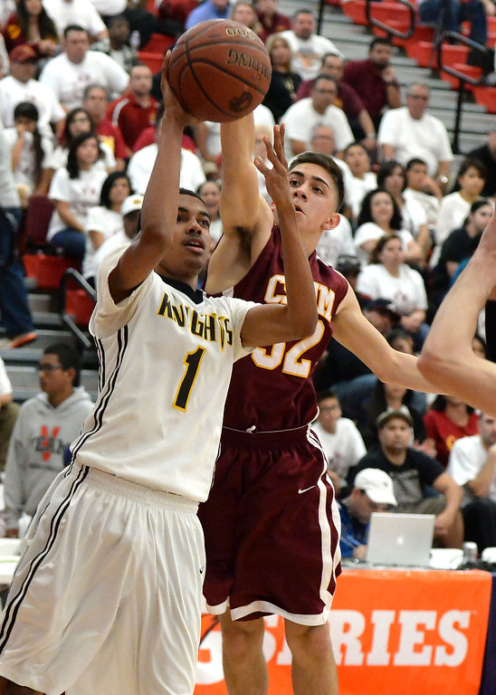 . Bishop Montgomery \'s Stephen Thompson Jr. (1) drives to the basket against Cantwell in the first half of a CIF Southern California Regional Division IV basketball game at Colony High School in Ontario, Calif., on Saturday, March 22, 2014.  (Keith Birmingham Pasadena Star-News)