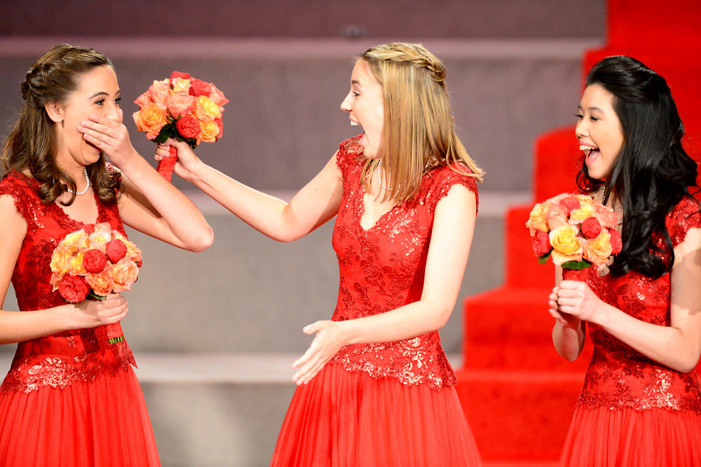. Ana Acosta, left, reacts as she is named the 96th Rose Queen during the Tournament of Roses\' coronation ceremony Thursday night, October 24, 2013 at the First Church of the Nazarene of Pasadena. Princesses Katherine Lipp and Elyssia Widjaja are right. (Photo by Sarah Reingewirtz/Pasadena Star-News)
