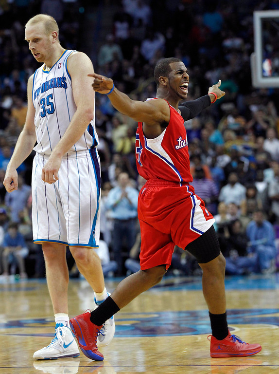 . Los Angeles Clippers guard Chris Paul (3) yells to officials and points at the clock after a foul as New Orleans Hornets center Chris Kaman (35)walks by, in the final minute of the second half of an NBA basketball game in New Orleans, Thursday, March 22, 2012. The Hornets won 97-90. (AP Photo/Gerald Herbert)