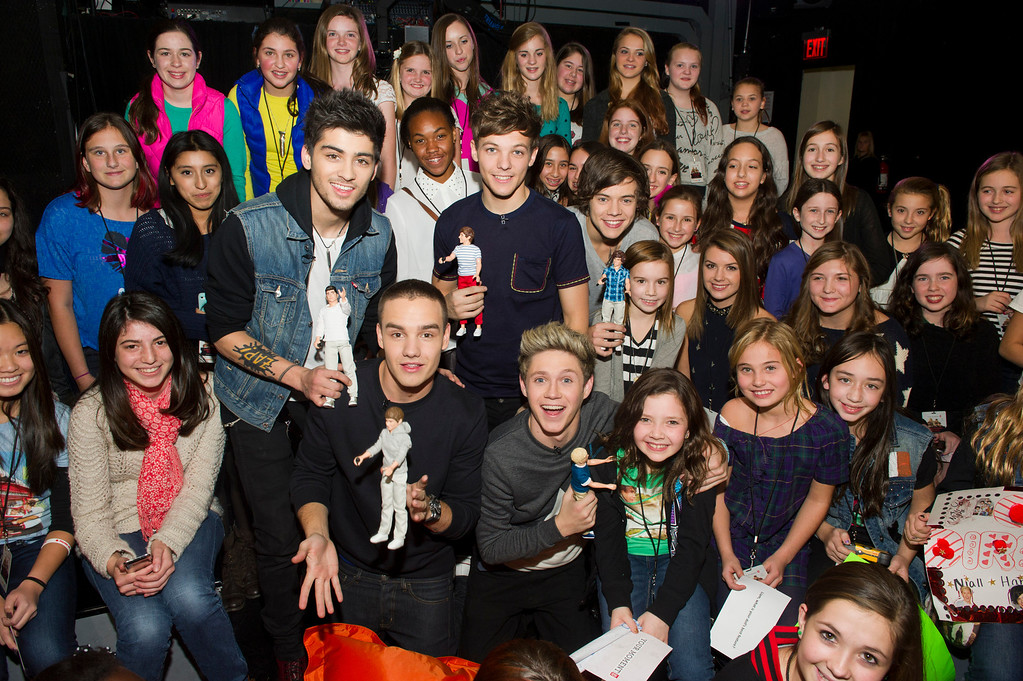 ". Worldwide musical sensation One Direction showcases their Hasbro dolls while greeting the winners of Nickelodeon\'s ""Your Moment with 1D\"" sweepstakes at an exclusive fan event on Monday, Nov. 26, 2012 in New York. (Photo by Charles Sykes/Invision for Hasbro/AP Images)"