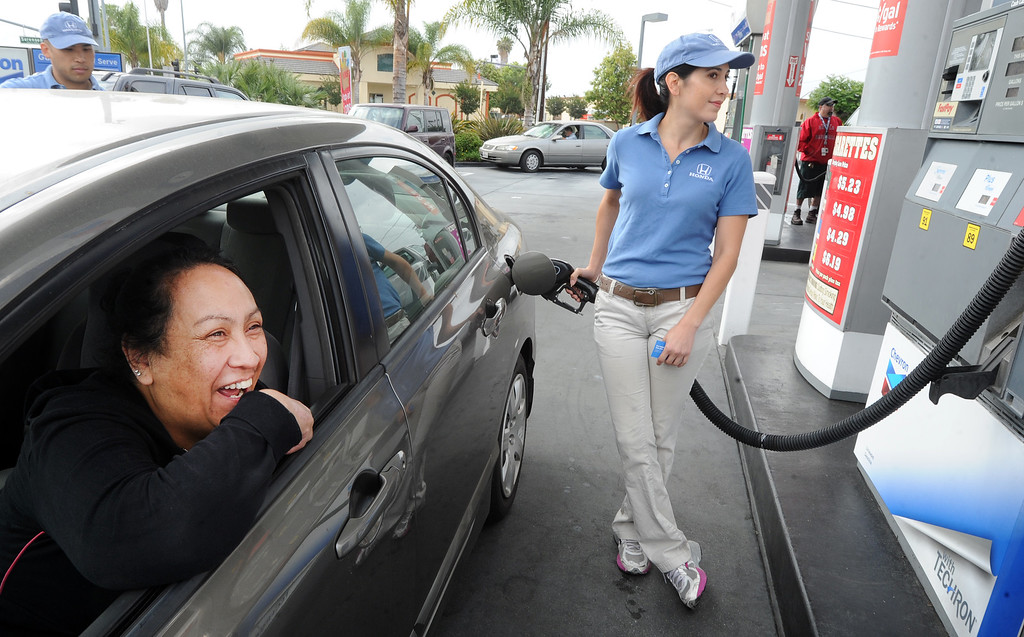 . Tamara Torres, Honda Helpful Team member, pumping free gas  in Nicole Ramos of Whittier, Honda car. As travelers hit the road tomorrow for Memorial Day Weekend, the Helpful Honda Guys in Blue will be meeting lucky drivers with an unexpected surprise�FREE GAS! Helpful teams will be paying at the pump for Honda drivers at gas stations across Southern California in over 20 cities, including Whittier, Friday May 24, 2013 and Memorial Day.(SGVN/Photo by Walt Mancini)