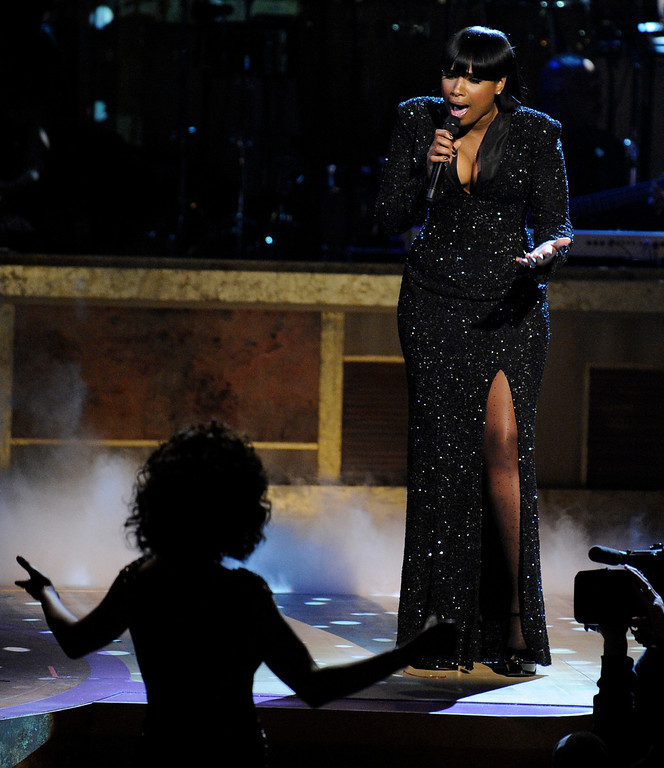 . Jennifer Hudson top, performs a tribute to Whitney Houston, left bottom, at the Warner Theatre during the 2010 BET Hip Hop Honors, Saturday, Jan. 16, 2010, in Washington.  (AP Photo/Nick Wass)
