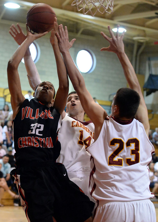 . Village Christian\'s Marsalis Johnson (C) (32) drives to the basket past Cantwell\'s Balsa Dragovic (14) and Gligorije Rakocevic (23) in the first half of a State Division 4 CIF Prep Playoff Basketball game at Whittier High School in Whittier, Calif., on Saturday, March 15, 2014. Cantwell won 51-48.  (Keith Birmingham Pasadena Star-News)