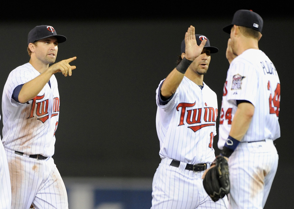 . MINNEAPOLIS, MN - SEPTEMBER 9: (L-R) Brian Dozier #2, Darin Mastroianni #19 and Trevor Plouffe #24 of the Minnesota Twins celebrate a win of the game against the Los Angeles Angels of Anaheim on September 9, 2013 at Target Field in Minneapolis, Minnesota. The Twins defeated the Angels 6-3. (Photo by Hannah Foslien/Getty Images)