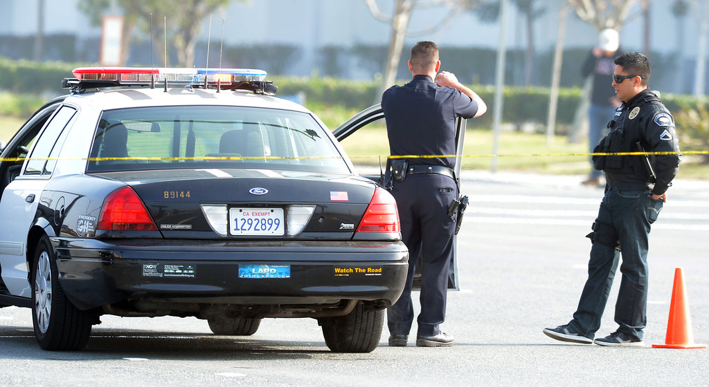 . LAPD investigators work a shooting scene where police officer was shot at by ex-LAPD officer Christopher Jordan Dorner in Corona February 7, 2013. (Staff  photo by Thomas Cordova/Inland Valley Daily Bulletin)