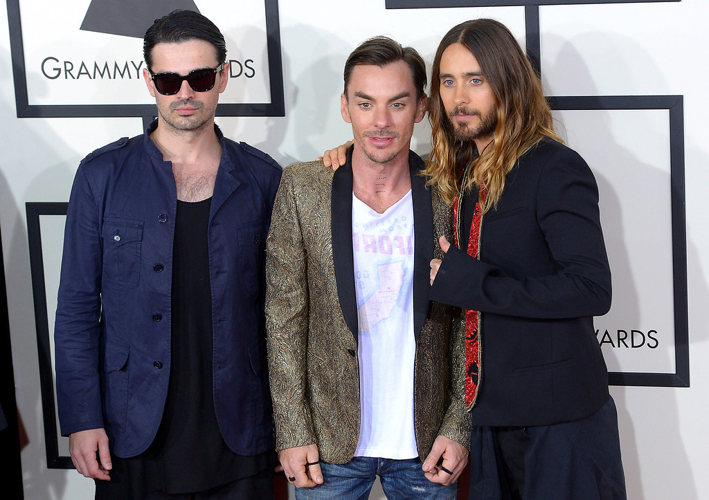 . Tomo Milicevic, Shannon Leto and Jared Leto of Thirty Seconds To Mars  arrive at the 56th Annual GRAMMY Awards at Staples Center in Los Angeles, California on Sunday January 26, 2014 (Photo by David Crane / Los Angeles Daily News)