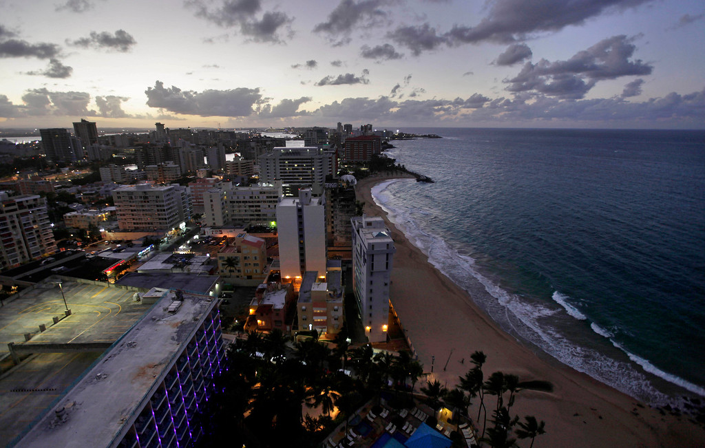 . FILE - In this Oct. 25, 2010 file photo, the Atlantic Ocean laps the shoreline of San Juan, Puerto Rico, seen from a high-rise.  (AP Photo/Brennan Linsley, File)