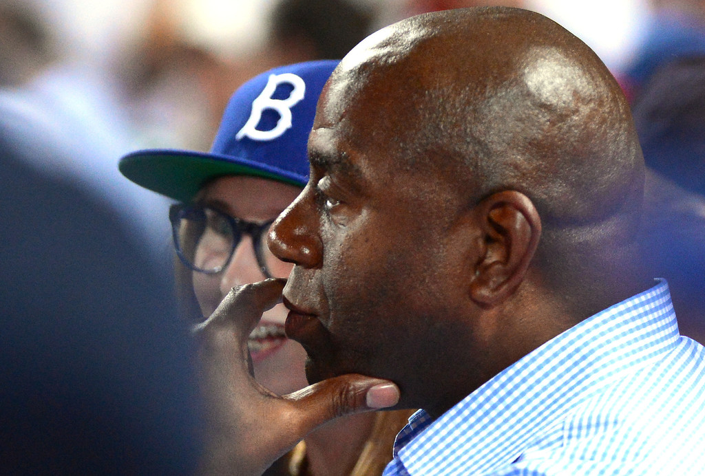 . Magic Johnson watches the Los Angeles Dodgers defeat the Atlanta Braves 6-1 in the first game of the playoffs Thursday, October 3, 2013 at Turner Field in Atlanta, Georgia. (Photo by Sarah Reingewirtz/Pasadena Star- News)