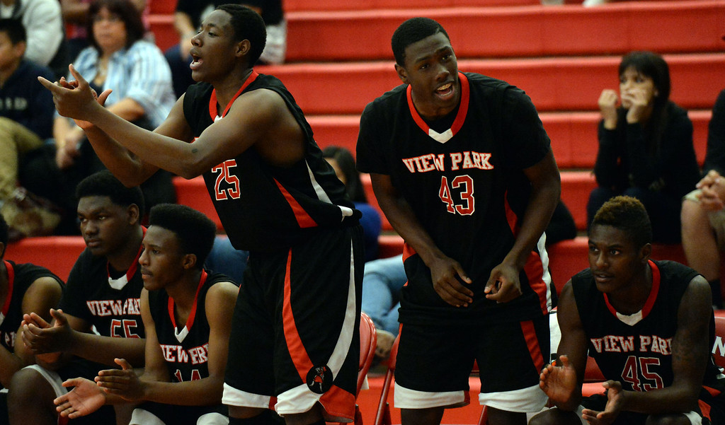 . View Park\'s Gene James (25) reacts along with Tyson Powell (43) after a three pointer against Renaissance Academy in the first half of a CIF Southern California Regional Division basketball game at Colony High School in Ontario, Calif., on Saturday, March 22, 2014.  (Keith Birmingham Pasadena Star-News)