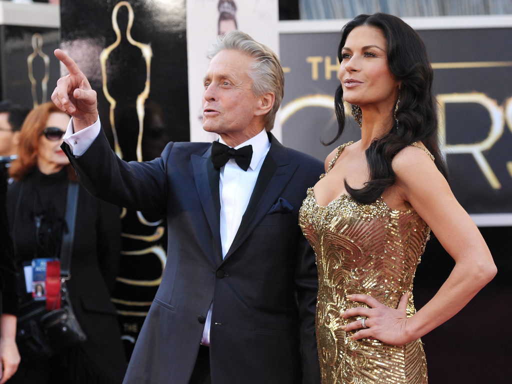 . Actors Michael Douglas, left, and Catherine Zeta-Jones arrive at the Oscars at the Dolby Theatre on Sunday Feb. 24, 2013, in Los Angeles. (Photo by John Shearer/Invision/AP)