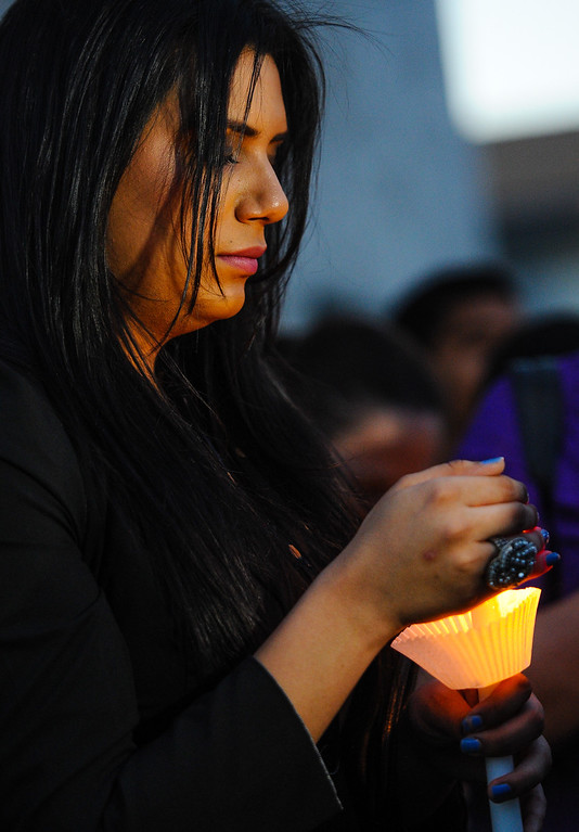 . Isabel Ramirez, 23, of Riverside, attends a candlelight vigil for Domonique Newburn, a Fontana transgender who was found dead on Tuesday, as friends and LGBT supporters hold a press conference outside Newburn\'s residence in Fontana on Wednesday, Aug. 21, 2013. Police have not made an arrest in the case, but say a man seen leaving Newburn\'s home in a Mercedes may be the suspect in the killing. The vehicle, which was found at Perris Hill Park Wednesday in San Bernardino, is believed to belong to Newburn. (Rachel Luna / Staff Photographer)
