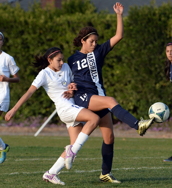 . Marshall\'s Jennifer Lopez (12) controls the ball against Bishop Amat\'s Ashley Garnica (17) in the first half of a prep soccer match at Bishop Amat High School in La Puente, Calif., on Thursday, Jan. 9, 2014.Amat won 3-0. (Keith Birmingham Pasadena Star-News)
