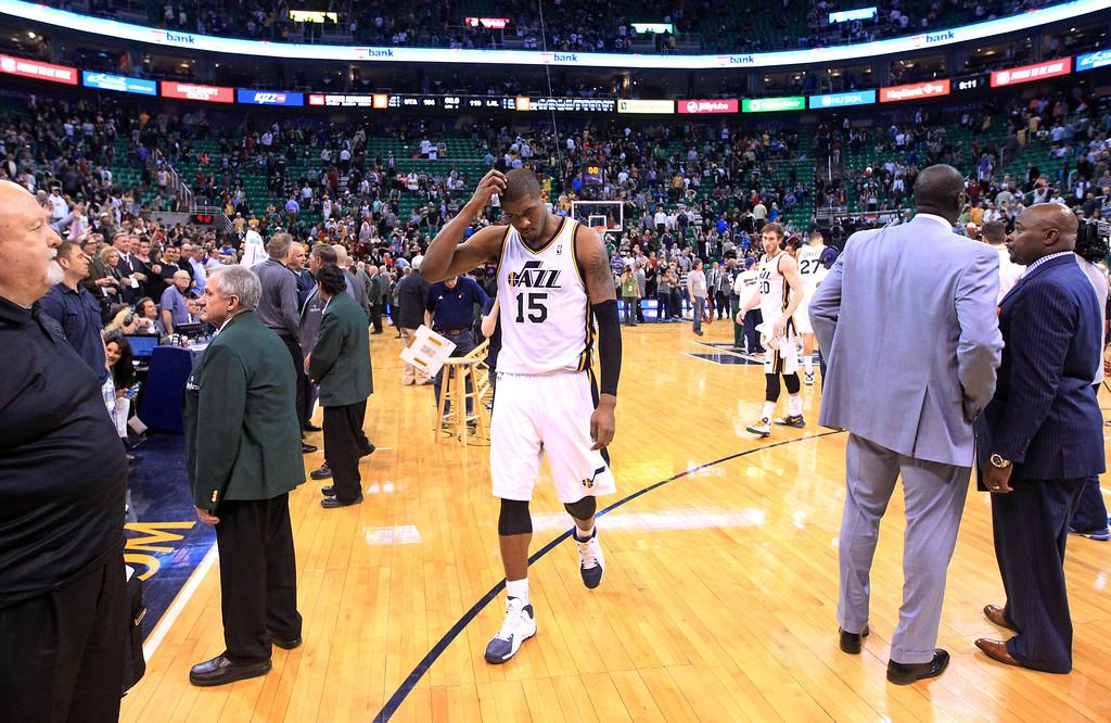 . Utah Jazz\'s Derrick Favors (15) walks off the court following their NBA basketball game against the Los Angeles Lakers Monday, April 14, 2014, in Salt Lake City, Utah. The Lakers won 119-104.  (AP Photo/Rick Bowmer)