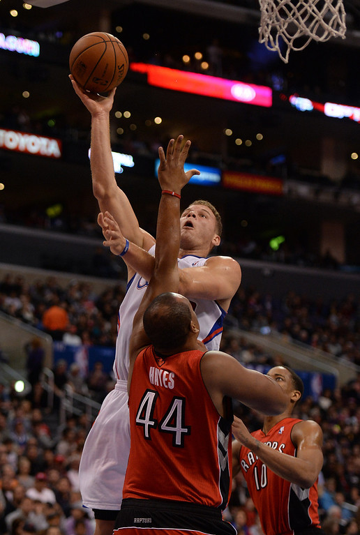 . The Clippers� Blake Griffin #32 shoots over the Raptors� Chuck Hayes #44 during their game at the Staples Center in Los Angeles Friday, February 7, 2014. (Photo by Hans Gutknecht/Los Angeles Daily News)