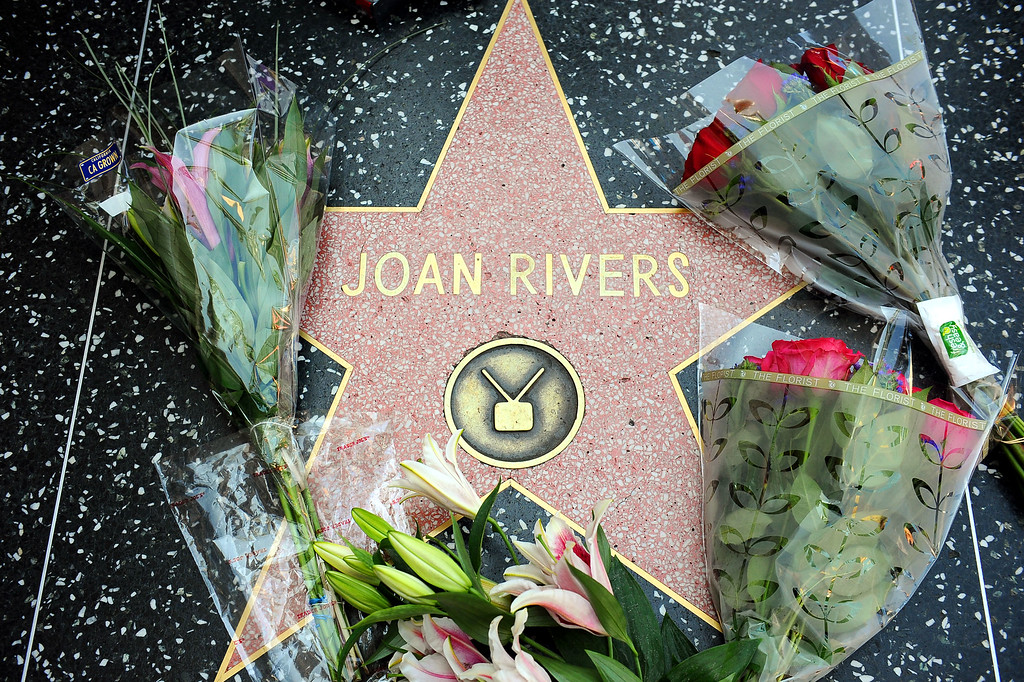 . Flowers are placed around Joan Rivers star on the Hollywood Walk of Fame after her passing Thursday, September 4, 2014.(Andy Holzman/Los Angeles Daily News)