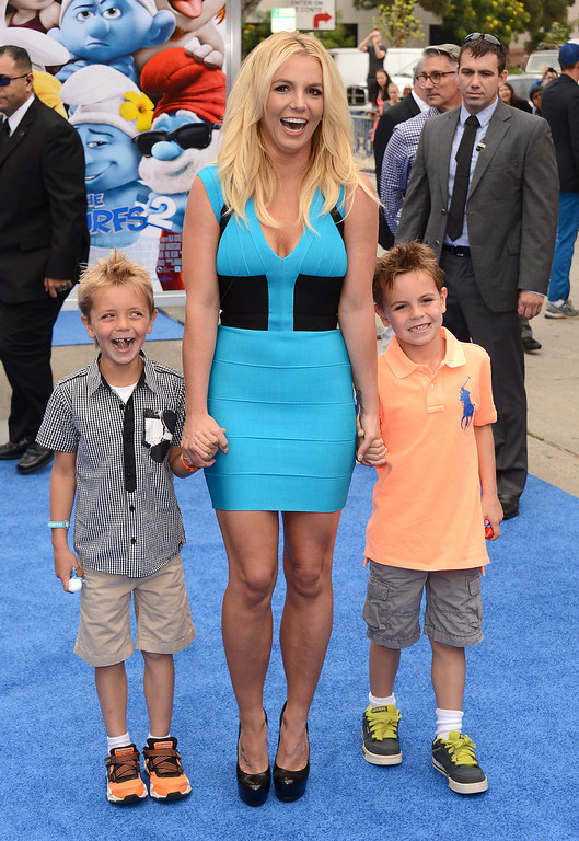 ". Singer Britney Spears, center, and her sons Sean Federline and Jayden James Federline  arrive at the world premiere of ""The Smurfs 2\"" at the Regency Village Theatre on Sunday, July 28, 2013 in Los Angeles. (Photo by Jordan Strauss/Invision/AP)"