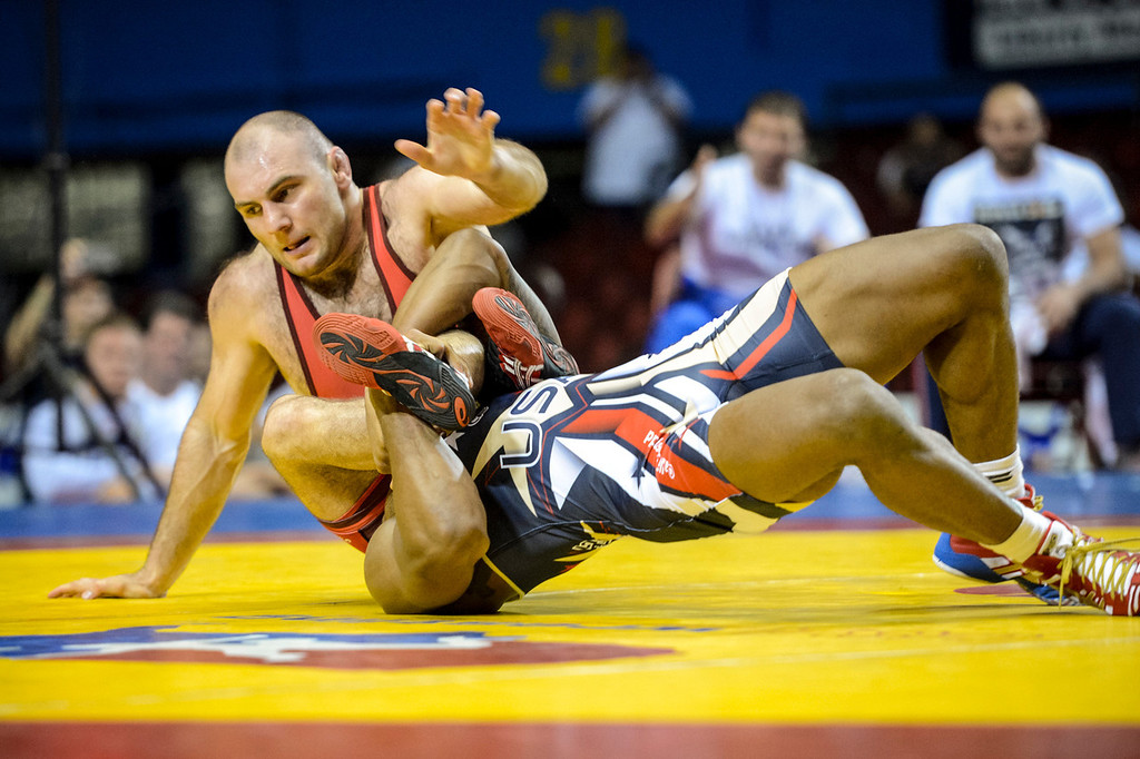 . USA\'s Jordan Burroughs takes on Russia\'s Saba Khubetzhty at the USA vs Russia vs Canada dual meet at the Sports Arena Sunday.  Burroughs beat Khubetzhty in the first round.   Photo by David Crane/Los Angeles Daily News.