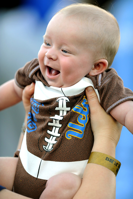 . Four-month-old Dylan Kroeger wears a football outfit at the UCLA-Nevada game at the Rose Bowl, Saturday, August 31, 2013. (Michael Owen Baker/L.A. Daily News)
