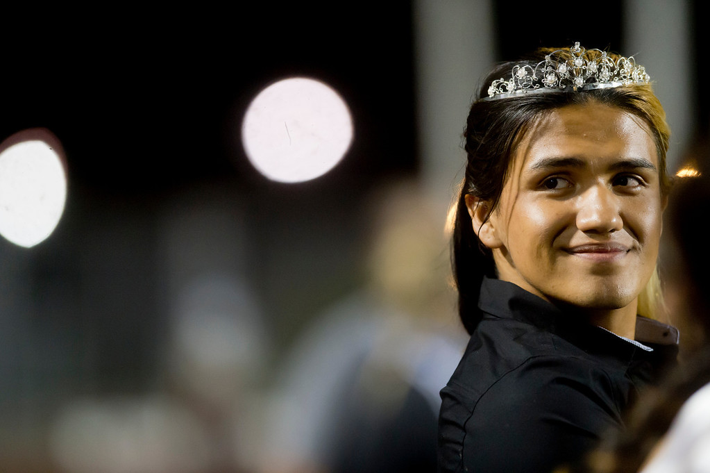 . Patrick Cordova, 16, right, a transgender senior who is running for Azusa High 2013 Homecoming Queen looks into the crowd during the homecoming game at Citrus College Stadium in Glendora on Friday night, Sept. 27, 2013.( Photo by Watchara Phomicinda/ San Gabriel Valley Tribune)