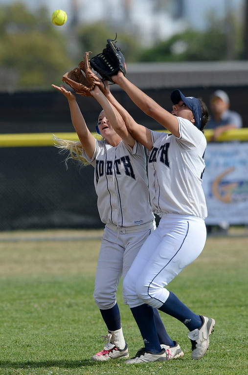 . North\'s Amber Perez (17) and Vanessa Gonzalez (77) collide while trying to field a shallow Peninsula hit, causing each other to miss the catch, in a first round CIF SS Division III softball game Thursday in Torrance. Peninsula won 4-1. 20130516 Photo by Steve McCrank / Staff Photographer