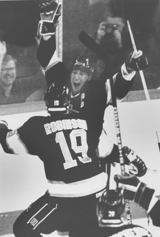 . Wayne Gretzky of the Los Angeles Kings cheers after he scored his 1,851st point in the National Hockey League in Edmonton, Alberta, Sunday, Oct. 15, 1989.  Gretzky surpasses Gordie Howe\'s NHL scoring record of 1,850 points.  Congratulating Gretzky is teammate Larry Robinson (19).  Gretzky scored with 53 seconds left in the third period of Sunday night\'s game against Edmonton Oilers.  (AP Photo/Jack Smith)