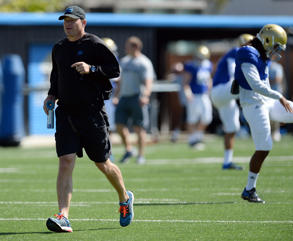 . UCLA head coach Jim Mora during football practice at  Spaulding Field on the UCLA campus Saturday 5, 2014.  (Photo by Hans Gutknecht/Los Angeles Daily News)