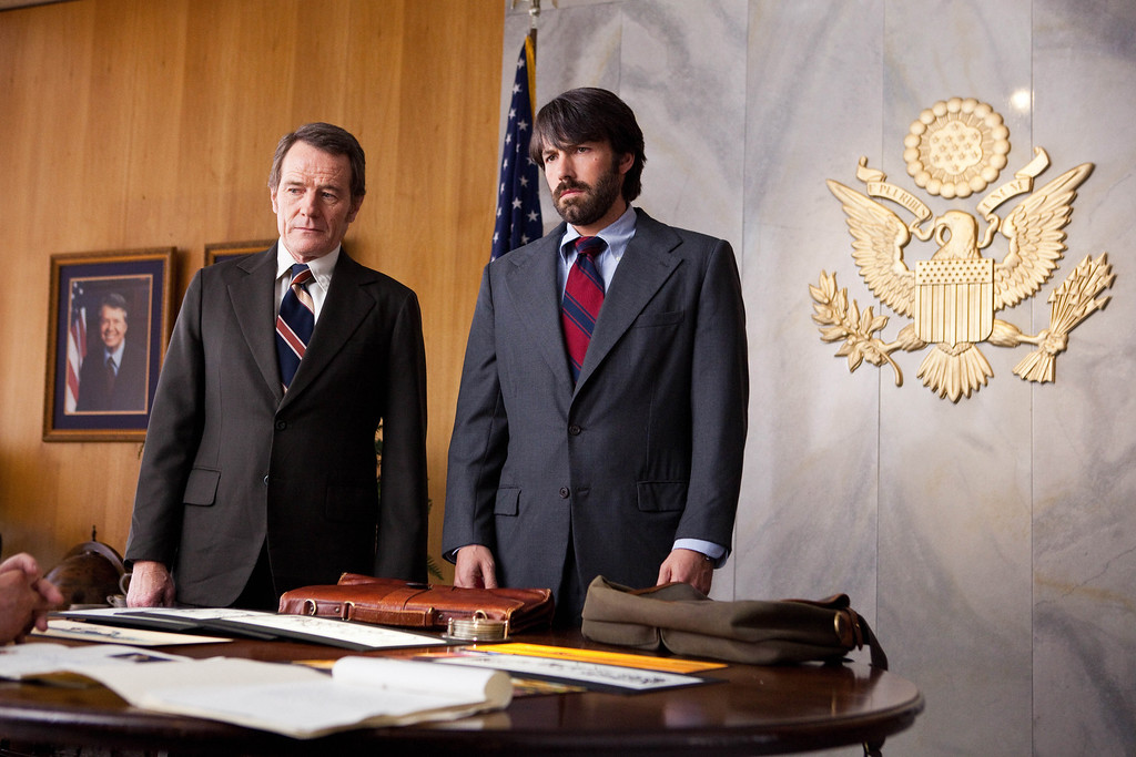 """. FILE - This undated publicity film image released by Warner Bros. Pictures shows Bryan Cranston, left, as Jack OíDonnell and Ben Affleck as Tony Mendez in \""""Argo,\""""  a rescue thriller about the 1979 Iranian hostage crisis.  Best-picture prospects for Oscar Nominations on Thursday, Jan. 10, 2013, include, �Lincoln,� directed by Steven Spielberg; �Zero Dark Thirty,� directed by Kathryn Bigelow; �Les Miserables,� directed by Tom Hooper; �Argo,� directed by Ben Affleck; �Django Unchained,� directed by Quentin Tarantino; and �Life of Pi,� directed by Ang Lee.  (AP Photo/Warner Bros., Claire Folger, File)"""