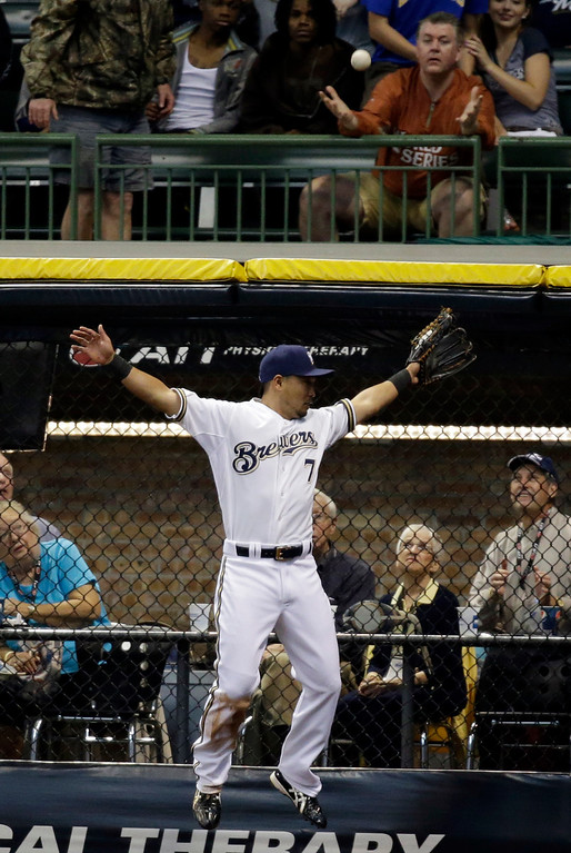. Milwaukee Brewers\' Norichika Aoki, of Japan, can\'t catch a home run hit by Los Angeles Dodgers\' Ramon Hernandez during the third inning of a baseball game Wednesday, May 22, 2013, in Milwaukee. (AP Photo/Morry Gash)