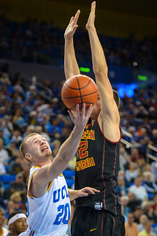 . UCLA�s Bryce Alford puts up two point as USC�s Nikola Jovanovic defends on the play during game action at Pauley Pavilion Sunday, December 5, 2014. UCLA  defeated USC 107-73.  Photo by David Crane/Los Angeles Daily News.